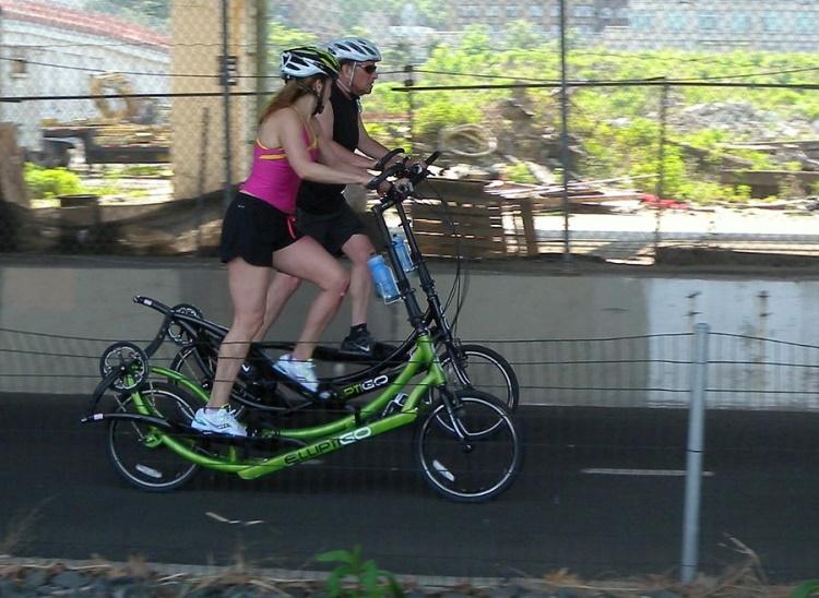 Couple using Elliptical Bikes
