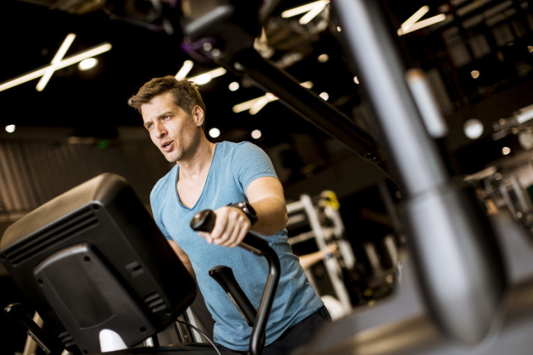 Man Exercising on Elliptical Cross Trainer