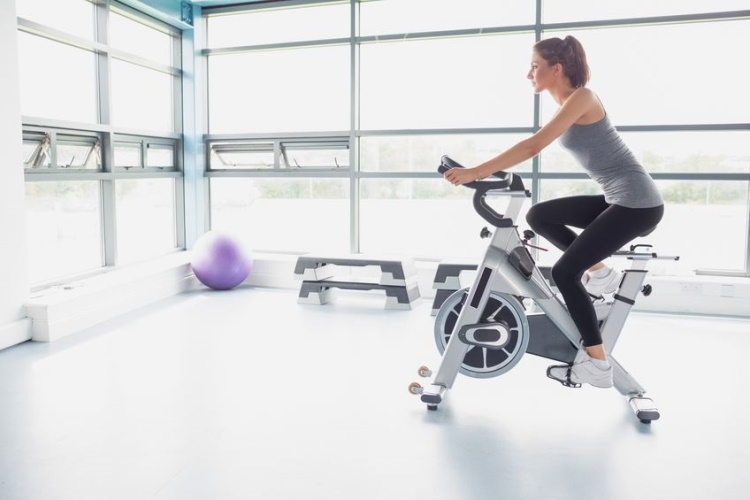 Woman Getting a Cardio Workout on Spin Bike