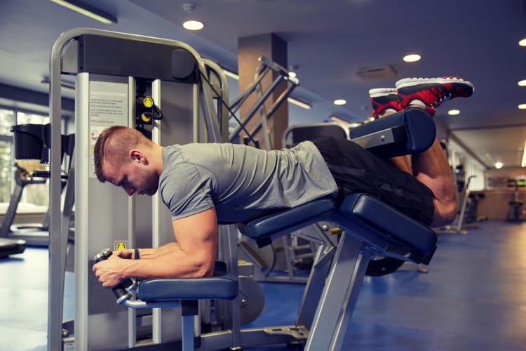 Exercising on Leg Curl Machine