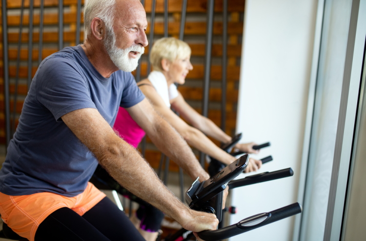 Senior Couple Indoor Cycling